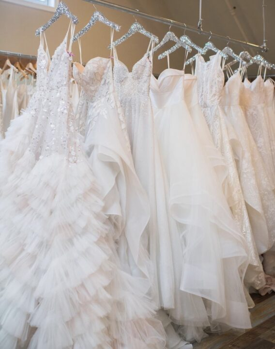 hayley paige wedding gowns on rail in wedding salon