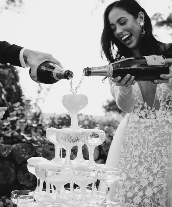 bride and groom wedding celebration with champagne tower wedding decor detail photo by ivy road photography