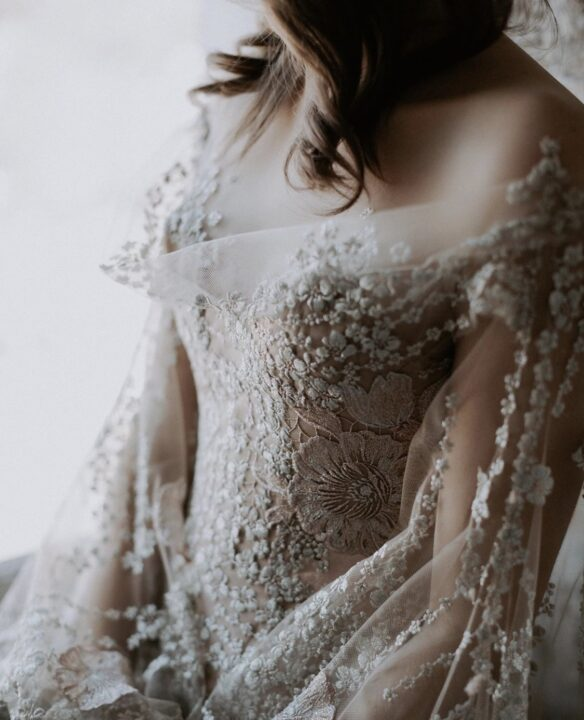 Jaton couture wedding gown with decorative lace appliqué bodice