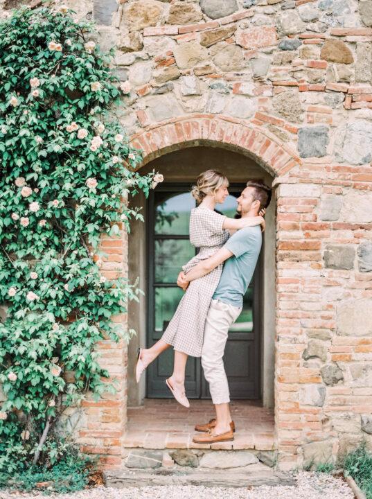 Newly engaged couple at romantic Tuscan villa