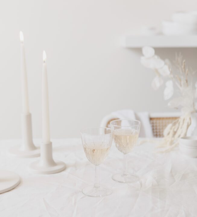 A romantic date night set up with rustic wedding vibes, wine and candlelight and dried flowers