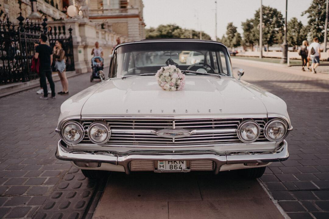 Wedding car with bouquet at Várkert Bazár, Budpest by Dream Weddings Budapest