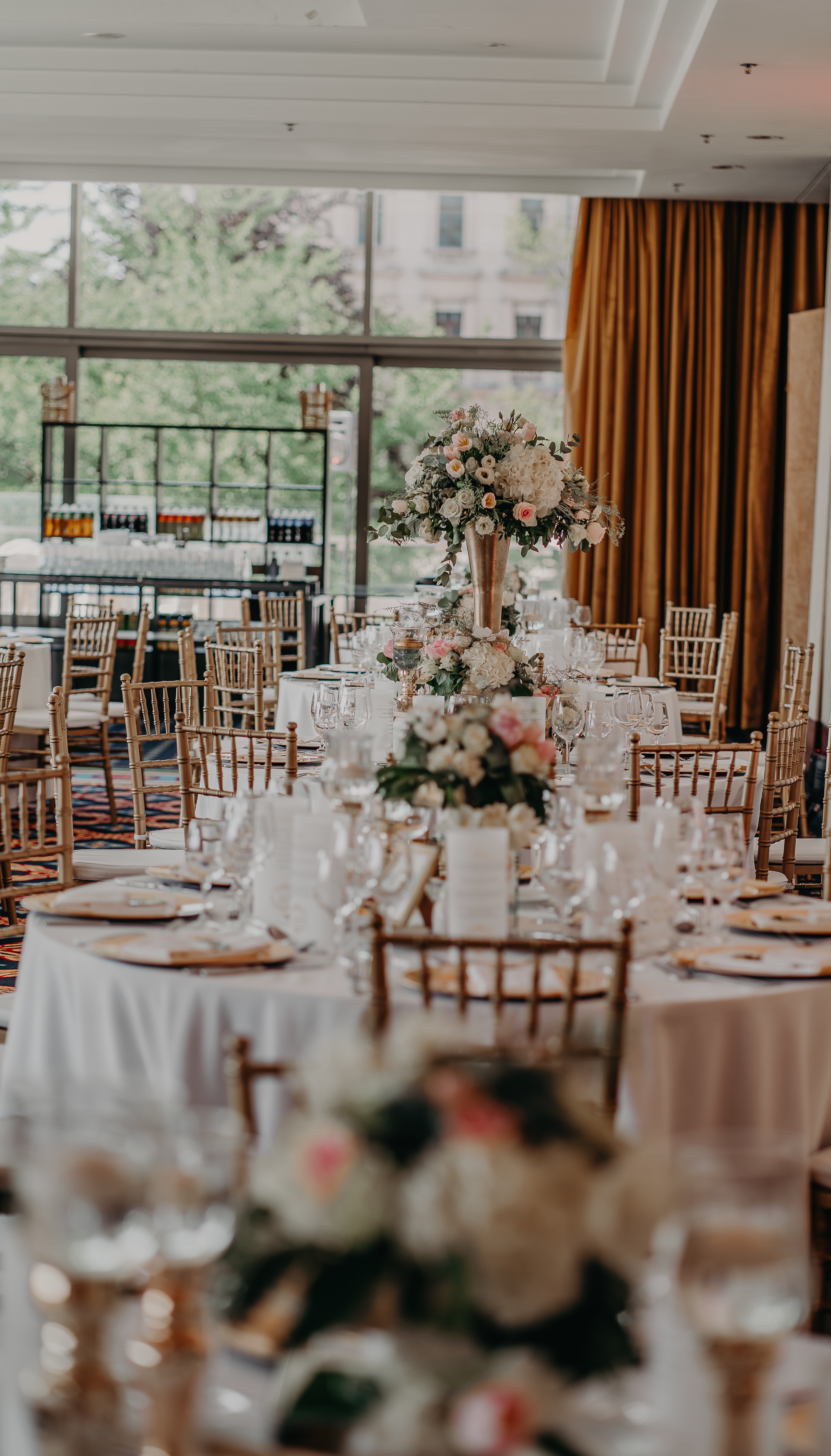Floral centerpieces and gold chiavari seats at Budapest Marriott Hotel