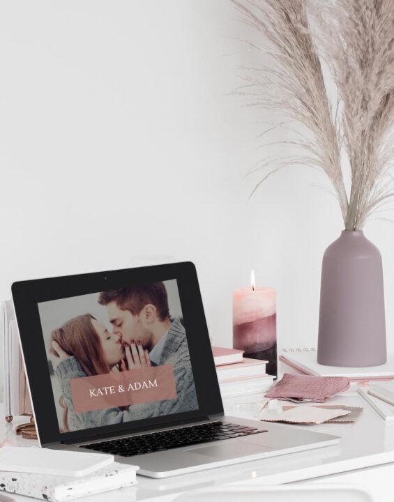Wedding website on laptop of wedding planners desk