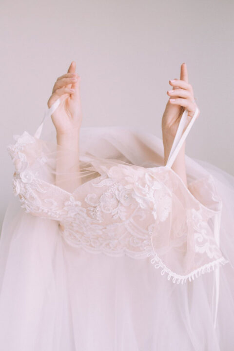 Bride slipping into her wedding dress