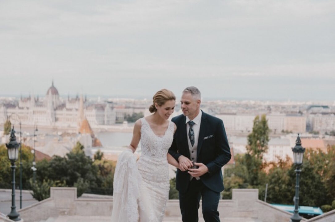 wedding in the castle district of Budapest with Danube view and Hungarian Parliament in the background, classic bridal hair and form fitting lace wedding dress