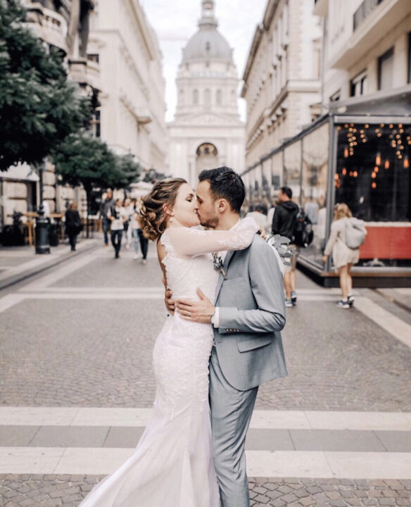 couple kiss after their in wedding in Saint Stephen's Basilica with bride in a backless wedding dress