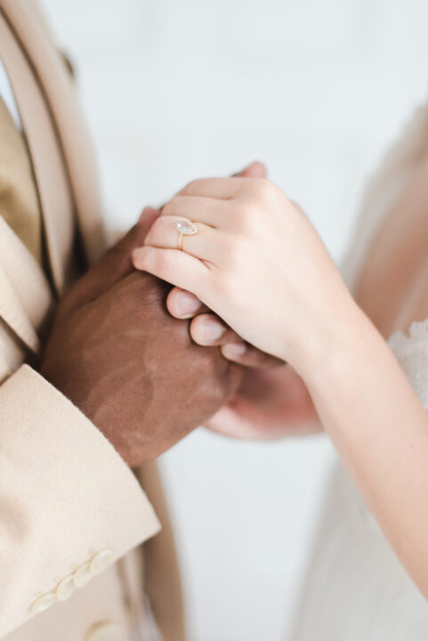 Getting married legally in Hungary, wedding couple hand in hand, inter racial wedding, marry in Budpest