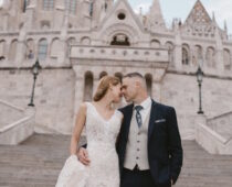 fairytale wedding portraits at Fisherman's Bastion Budapest, with Mathias Church in the background
