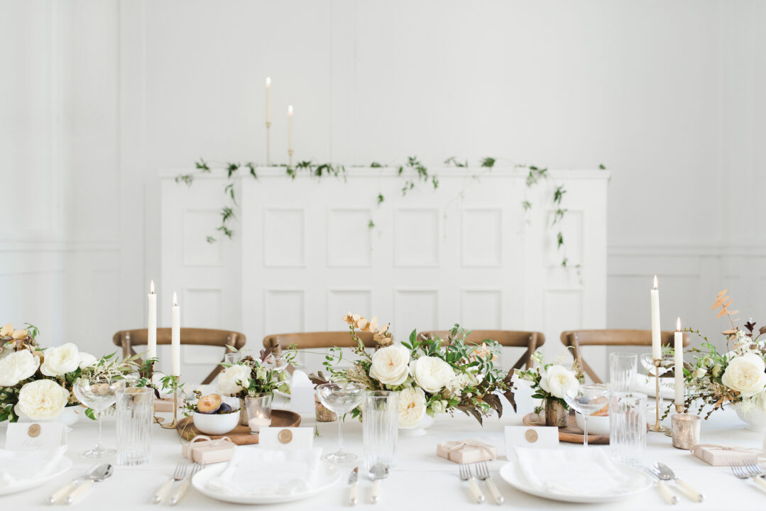wedding decor with rustic furniture, crisp whites and greenery
